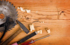 Tools on a wooden background Stock Images