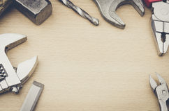 Tools on a wooden background. Wooden desk with different tools Stock Photography