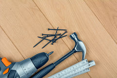 Tools on a wooden background Royalty Free Stock Image