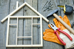 Tools on wooden boards with house Stock Images