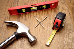 Tools on wooden panel Stock Image