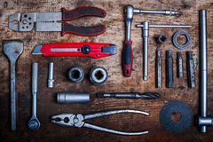 Tools on wooden plank Stock Photography