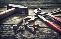 Tools on wooden surface Royalty Free Stock Images