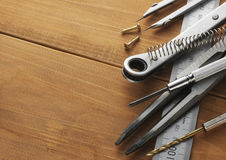 Tools on wooden table Royalty Free Stock Image