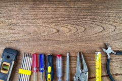 Tools. On a wooden table background Stock Photography