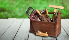 Tools on wooden table in the summer garden on a sunny day stock image