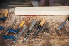 Tools for wooden work. On a wooden board royalty free stock images
