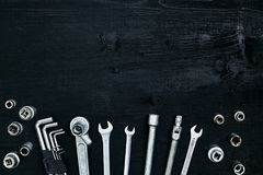 Tools for work or repair auto on black wooden background. Top view royalty free stock images