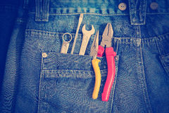 Tools on a workers pocket. Stock Photos