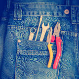 Tools on a workers pocket. Stock Photography