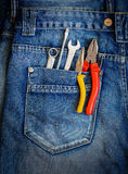 Tools on a workers pocket. Royalty Free Stock Images