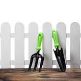 Tools for working in the garden. On the porch of a house isolated Stock Photography