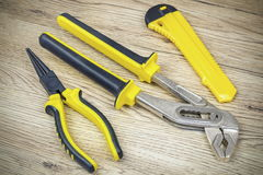 Tools in yellow on wood Royalty Free Stock Photos