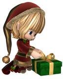 Toon Christmas Elf Wrapping sveglio un presente Immagini Stock