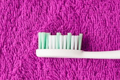 Toot brush on pink. Tooth brush situated on pink textile fibres Stock Images
