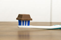 Tootbrush with chocolate on top Stock Image