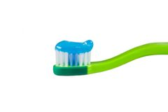 Tooth. Child's tooth brush with paste on the white background stock image