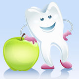Tooth and apple Stock Photography