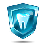 Tooth on a blue shield Stock Image