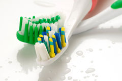 Tooth brush. On a white background with water Stock Photo
