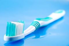 Tooth brush. Against a blue background Royalty Free Stock Photos