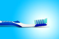 Tooth brush. In blue background Royalty Free Stock Images