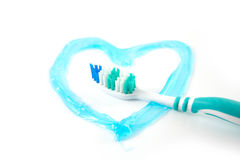Tooth brush. With a heart in tooth paste, so say that you love cleaning your teeth Royalty Free Stock Photography