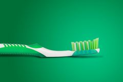 Tooth brush. In green background Stock Photo