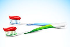 Tooth Brush. Illustration of tooth paste on tooth brush on abstract background Royalty Free Stock Images