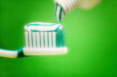 Tooth brush. With tooth paste over green background royalty free stock photo