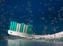 Tooth-brush. Under falling water drops Royalty Free Stock Image