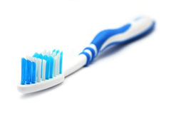 Tooth Brush. A blue white tooth brush on white background Royalty Free Stock Photography