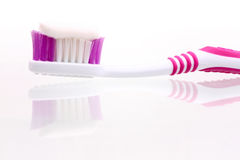 Tooth brush. Closeup with paste with reflections and shadows isolated on white - with handmade clipping-path Royalty Free Stock Images