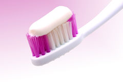 Tooth brush. Closeup with paste isolated on pink gradient - with handmade clipping-path Royalty Free Stock Photography