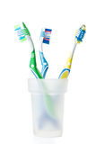 Tooth brush. In a glass on a white background Stock Photography