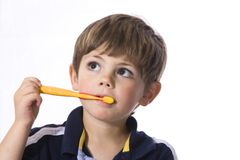 Tooth Brush boy. Young boy brushing his teeth with a yellow tooth brush Stock Photos