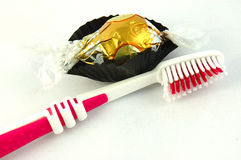 Tooth brush and chocolate Royalty Free Stock Images