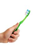 Tooth-brush in a hand Stock Photos