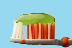 Tooth brush and paste. A close-up tooth brush with paste on it. Selecting path included Royalty Free Stock Images