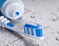 Tooth brush and paste Stock Photos
