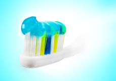 Tooth brush with paste. Tooth brush with paste on blue and white background Stock Photo