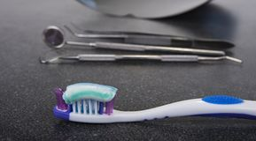 Tooth brush and paste with dental tools. Clean your teeth scene.  Royalty Free Stock Image