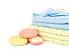 Tooth brush on the pile of towels and soap Royalty Free Stock Image