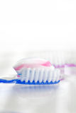 Tooth brush with tooth paste. On white background Stock Photo