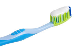 Tooth brush with tooth paste. Close-up tooth brush with tooth paste, isolated on white Royalty Free Stock Photography