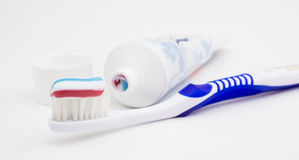 Tooth brush with tooth paste. On white background Stock Photos