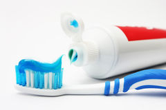 Tooth Brush And Tooth Paste. Blue dental brush with tooth paste on white background Royalty Free Stock Image