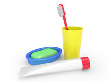 Tooth-brush, tooth-paste soap and a glass Royalty Free Stock Images