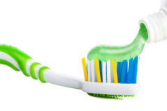 Tooth brush with tooth paste. On white background Royalty Free Stock Photo