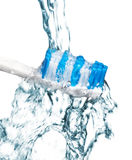 Tooth brush under water. Cleaning a tooth brush under water Stock Photography